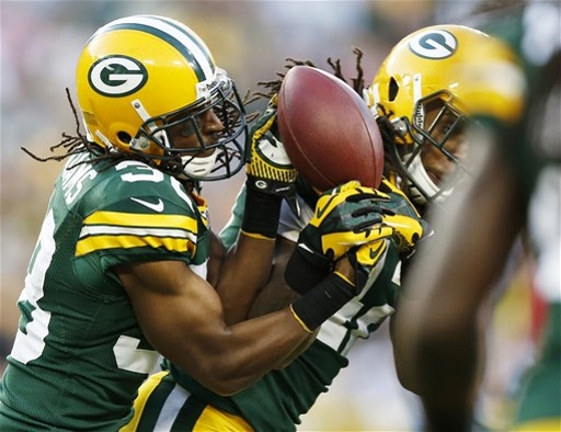 CB Tramon Williams and S Morgan Burnett fight for an interception against the Saints