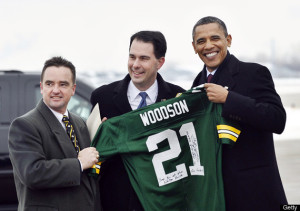 President Obama (D) holds a Charles Woodson jersey along with Wisconsin Gov. Scott Walker (R)