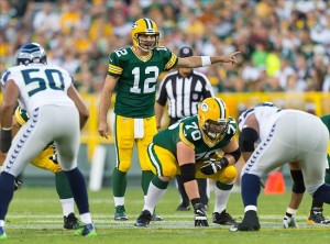 Will Aaron Rodgers be leading an up-tempo or no huddle offense in 2014? (Photo credit: Jeff Hanisch/USA Today).